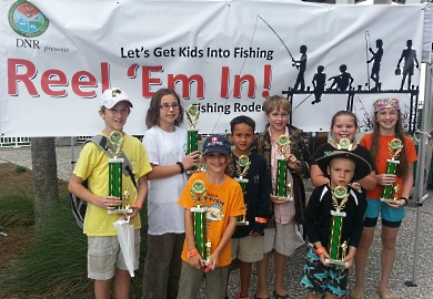 Winners from last year's Reel 'Em In fishing tournament show off their hardware. This year's tournament is set for Oct. 29 at the Mount Pleasant Pier in Charleston. (SCDNR photo)