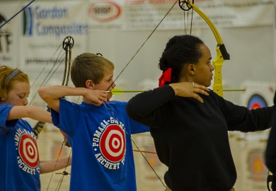Student archers from Pomaria Middle School in S.C.  (blue shirts) along with fellow competitors from other states, show their intensity at the NASP World Tournament in Myrtle Beach.  photo by David Lucas, SCDNR