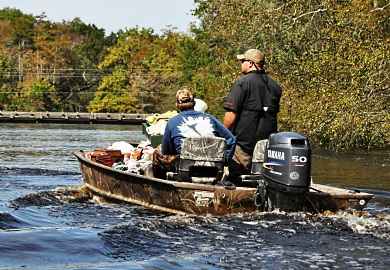 Boaters at low speed, creating little to no wake