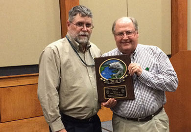 Paul McKee (right) receives the award as Certified SCDNR Fishing Instructor of the Year from Ross Self, SCDNR chief of freshwater fisheries.