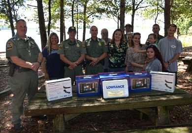 The family of the late Mitchell Don Gibson, a commercial fisherman who was lost on Lake Russell in March 2016, displays the three Lowrance digital side-scanning imaging units that were donated to South Carolina Department of Natural Resources (SCDNR) Region One Law Enforcement to help officers search for drowning victims.
