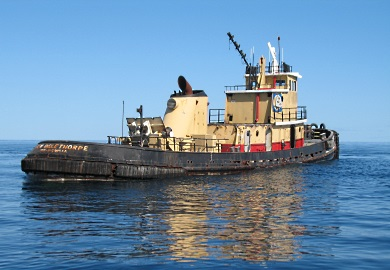 The Gen. Oglethorpe, a retired tugboat, rests on calm seas just before sinking. (Photo: Robert Martore/SCDNR)