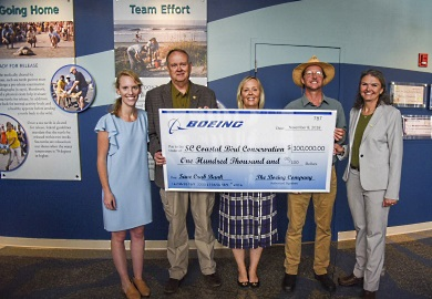 Boeing South Carolina has provided a generous donation of $100,000 to the support the efforts of the South Carolina Coastal Bird Conservation Program to restore critical sea and shorebird nesting habitat on the SCDNR's Crab Bank Seabird Sanctuary. Pictured at the November 8 ceremony dedicating the gift are (left to right): Coastal Conservation League Communications Director Caitie Forde-Smith, SCDNR Director Alvin Taylor, Boeing S.C. Senior Director of National Strategy and Engagement Lindsay Leonard, the Coastal Expeditions Foundation's Capt. Chris Crolley and Audubon S.C. Executive Director Sharon Richardson. [SCDNR photo by Taylor Main]