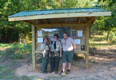 Eagle Scout David Helm (center) of Spartanburg completed the requirements of his Eagle Scout award by designing and leading construction of a kiosk at Thurmond Dove Field in Union County, a public dove field managed by the South Carolina Department of Natural Resources (SCDNR). At left is David's mother, Audra, and at right is Craig Brooks, Scoutmaster of Troop 5 at St. John's Lutheran Church in Spartanburg. (Photo: Greg Lucas/SCDNR)