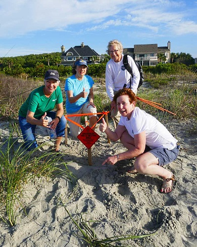Volunteers with the Isle of Palms/Sullivan's Island turtle team celebrate the state's first nest of the season. (Photo: Barb Bergwerf)