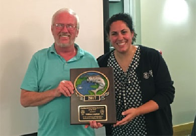 "SCDNR Aquatic Education Coordinator Sarah Chabaane presents William ""Billy"" Armfield with the Certified SCDNR Fishing Instructor of the Year award."