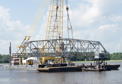 The bridge section is lowered onto a waiting barge. (Photo: Cameron Rhodes)