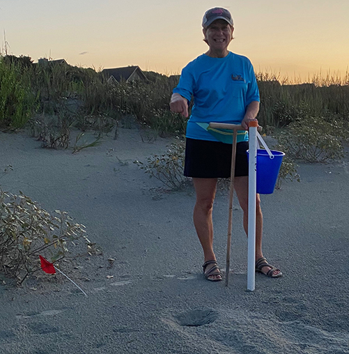 Kiawah Island Turtle Patrol member Barbara Pagnotta stands next to the state's first sea turtle nest to hatch in 2020. (Photo: Lynne Sager)