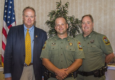 S.C. Department of Natural Resources Conservation Officer John 'J.P.' Jones (center) was presented with the agency's top honors by SCDNR Director Alvin Taylor (left) and Law Enforcement Division Deputy Director Col. Chisolm Frampton (right) at an awards ceremony helld October 5th in Columbia. [SCDNR photo by Taylor Main]
