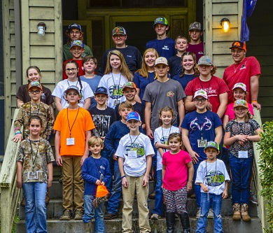 Participants in the 2019 S.C. State Youth Coon Hunt Championship pose for a group photo on the steps of the historic lodge at the SCDNR's James W. Webb Wildlife Center. [SCDNR photo by D. Lucas]