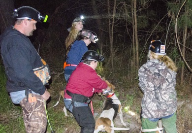 Youth hunters prepare to release their hounds at the 2017 South Carolina State Youth Raccoon Hunting Championship. No raccoons are killed during these competitions.  Instead, points are awarded by judges based upon the order that the contestants interpret their dogs' barks to identify when the dogs strike a raccoons' trail and when their dogs have treed a raccoon.   SCDNR photo by David Lucas