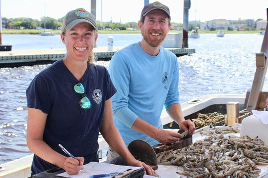 SCDNR biologists Kristin Hamilton and Mike Kendrick measure and count white shrimp aboard a regular trawl survey in 2018. (Photo: E. Weeks/SCDNR)