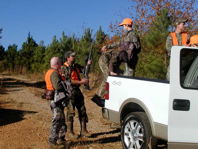 Youth deer hunt participants climbing into a truck