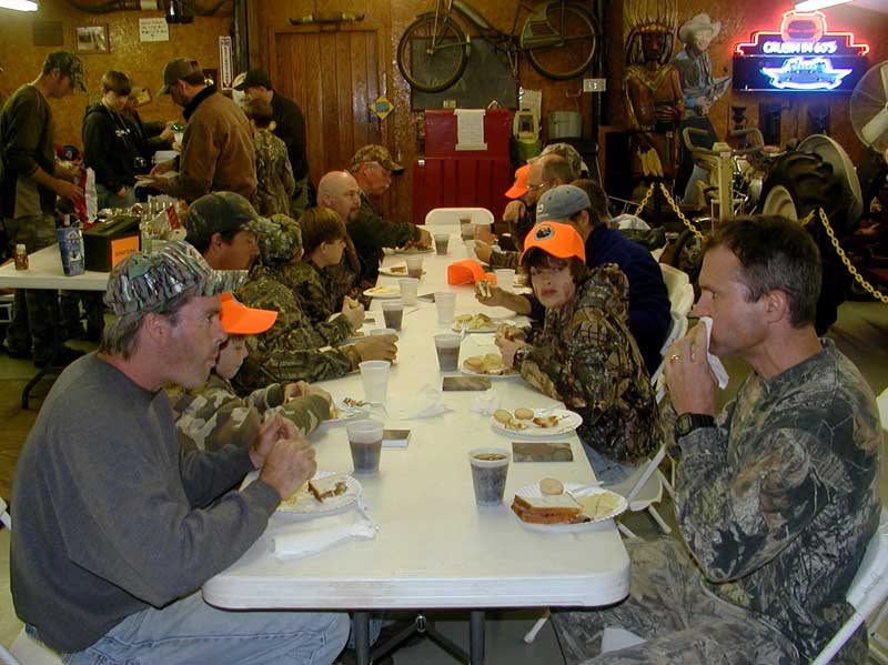 Youth deer hunt participants enjoying a meal.
