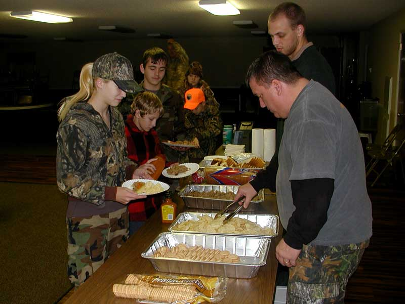 Youth deer hunt participants and parents preparing their plates.
