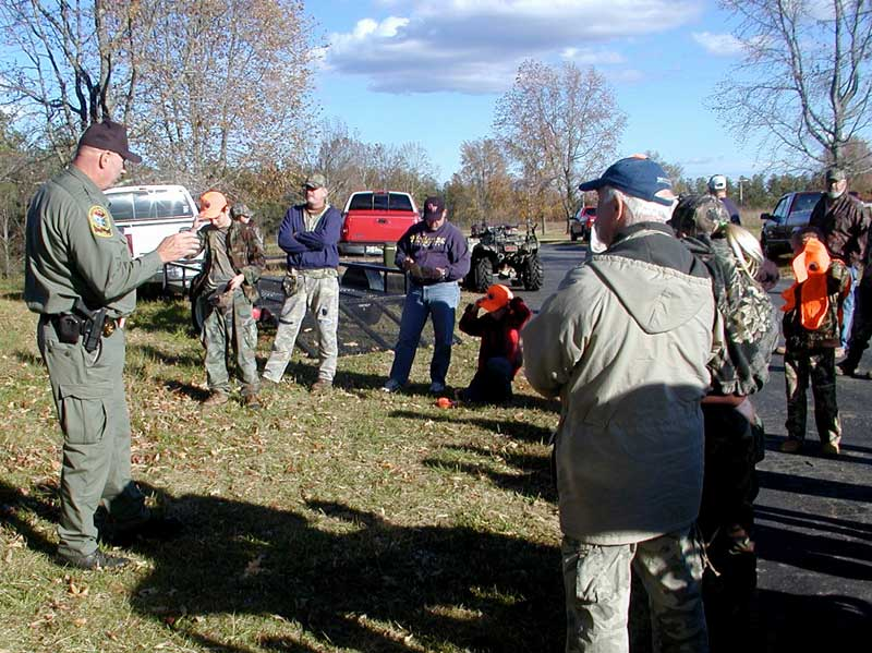 DNR Law Enforcement providing training and education at a youth deer hunt.