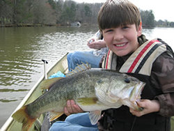 Boy holding a Large Mouth Bass